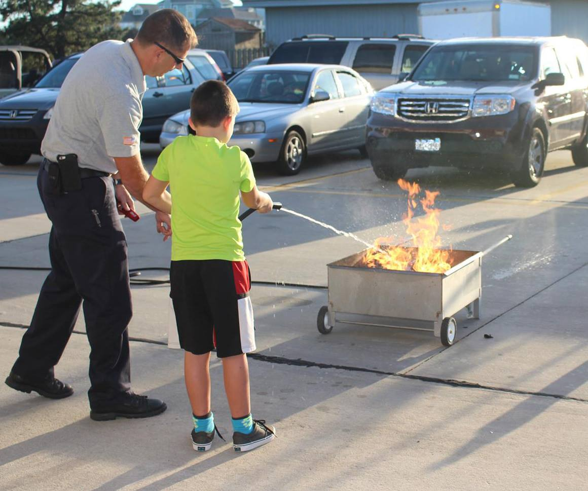 Man Teaching Fire Prevention to a Young Boy