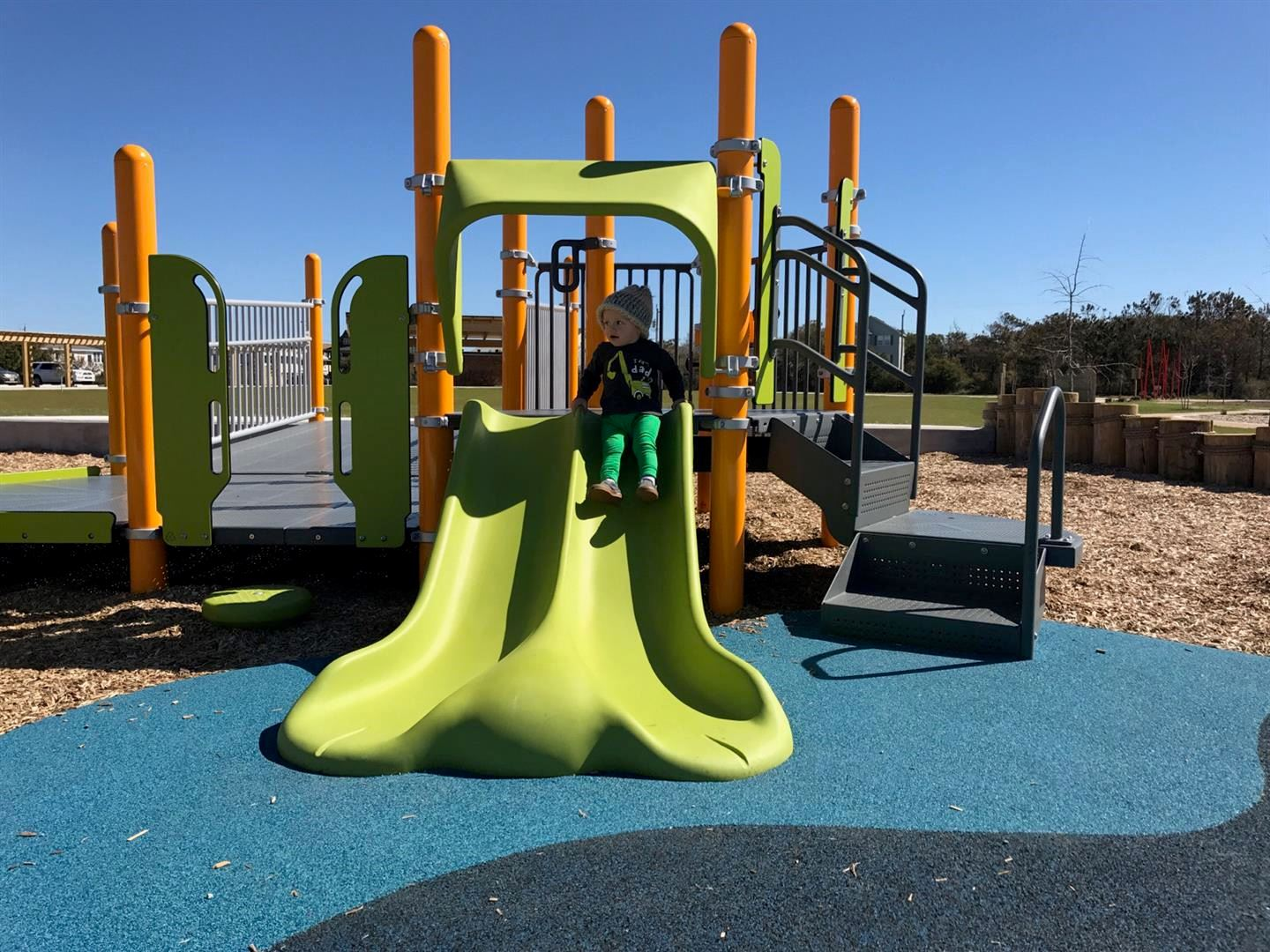 Child on a Green Slide