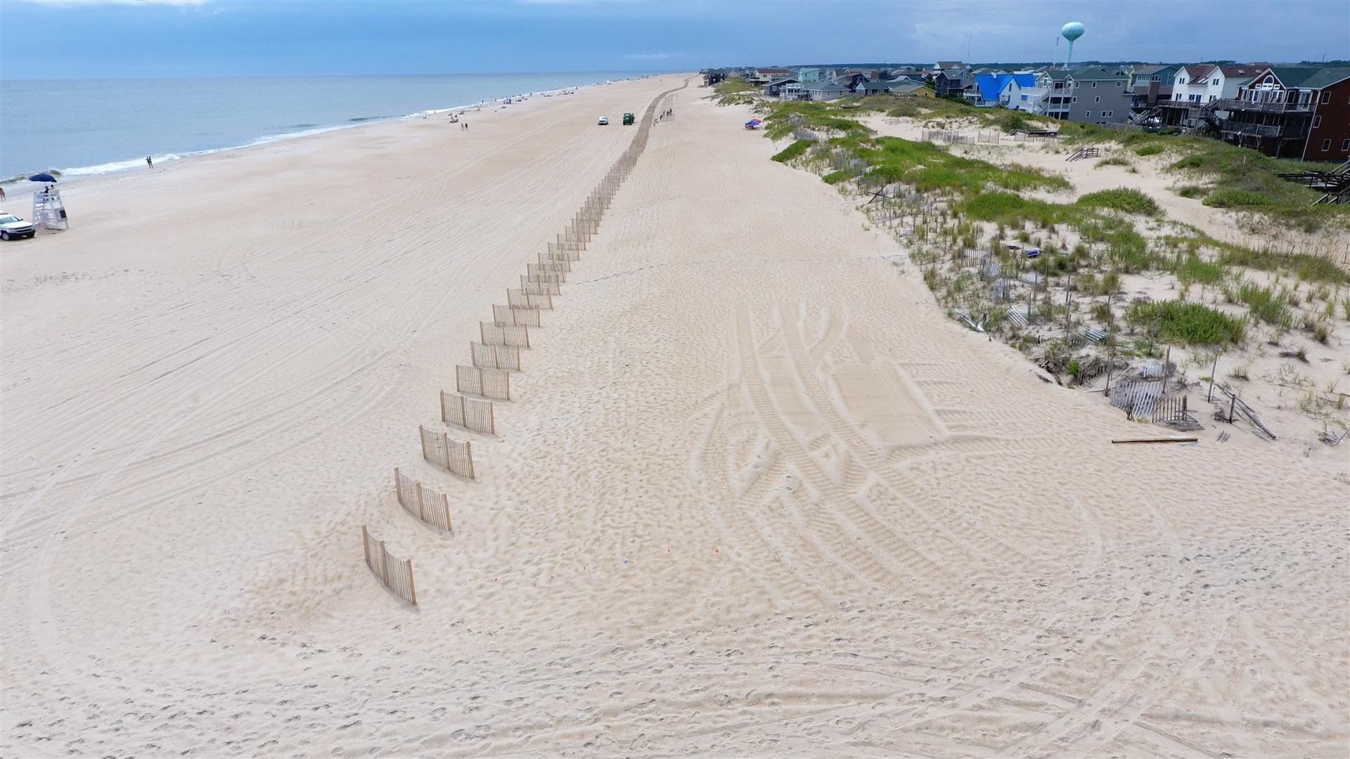Sand fencing installation in south Nags Head August 16, 2019.