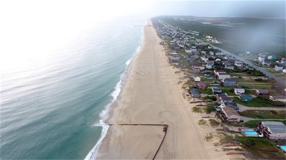 Nags Head's 10 mile-long beach nourishment project was completed early in the morning on Sunday, August 18, 2019 near Mile Post 17. Most of the equipment used during the project, such as the submerged line pictured here, has already been removed from the beach.
