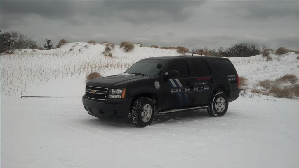 Dark Police SUV in Snowy Area