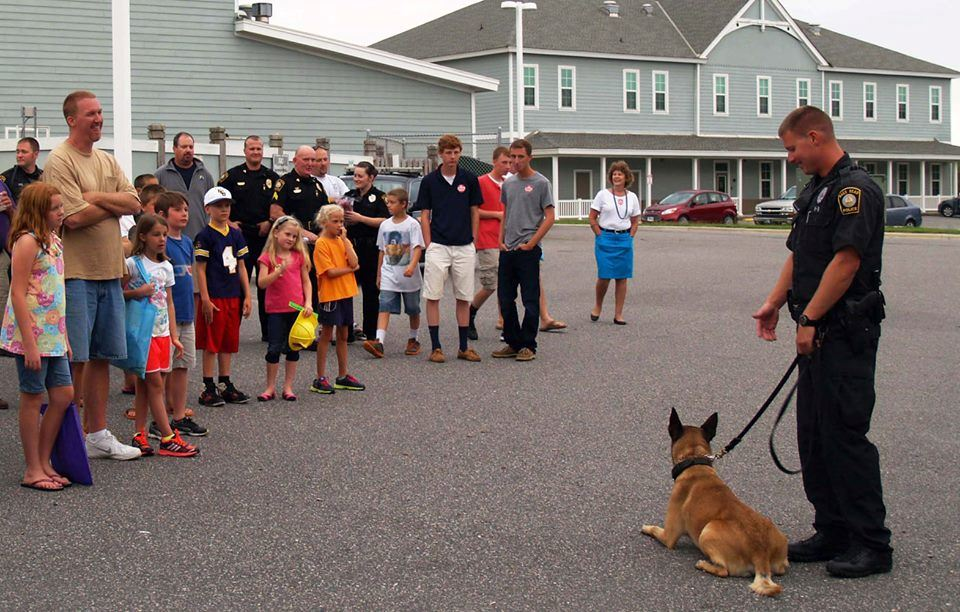 Officer and dog presenting to group